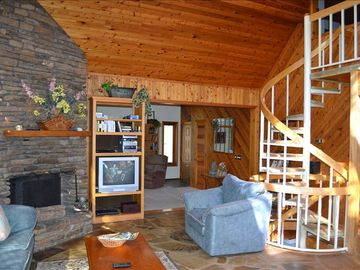 Garfield house rental - Large open family area with cedar wood & real Ozark stone floor & fireplace.
