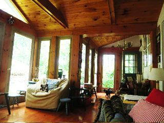 Great Barrington house photo - big porch facing gardens, with futon for sleeping and second large dining table