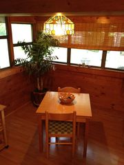 Breaux Bridge cottage photo - Breakfast nook with pantry offers great views of private cottage yard.