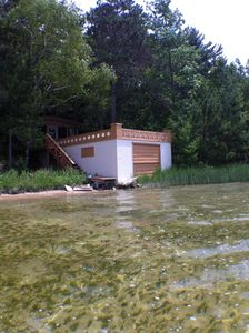 Beach, rehabbed boathouse 20 feet from shore; boats can be beached on shore