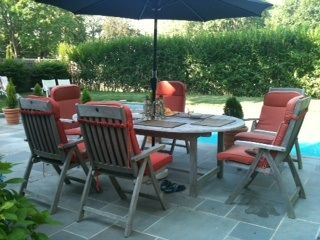 Bridgehampton cottage photo - Teak Table opens to seat 10 w/ comfy cushions and umbrella.