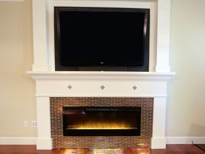 60' HDTV with cutting edge fireplace