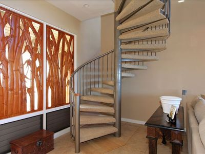 Custom Carved Window Coverings And Spiral Stairs to Upper Level