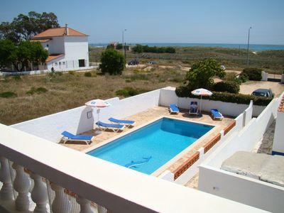 View of pool, beach and sea from villa