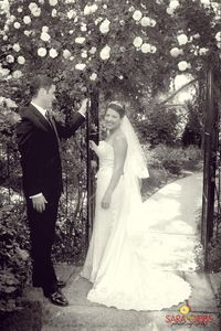 Rose arbor entry to canopied courtyard for your special wedding day