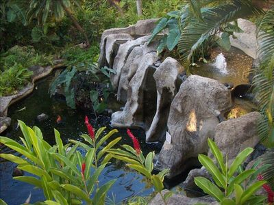 The grounds are beautifully maintained, including a koi fish pond with waterfall