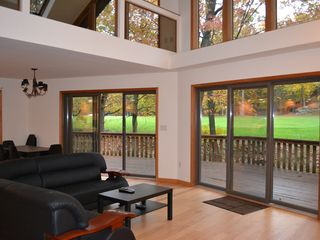 Lake Wallenpaupack property rental photo - Living room with a veiw of the golf course