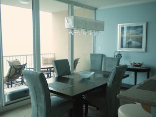 Gulf Shores condo photo - Very comfortable dining for six with gorgeous chandelier
