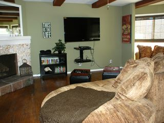 Oxnard house photo - Entertainment room with fireplace, X-box system, games and flat screen tv.