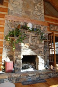2 story fireplace hand cut from stones in our stream - notice the music note!