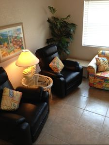 Very comfortable and colorful great room with two brand new leather recliners.