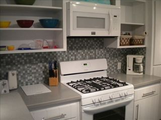 Cherokee Sound property rental photo - Completely new Corian Kitchen and appliances with outside charcoal BBQ