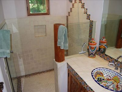 Second bathroom with huge shower and Mexican tile