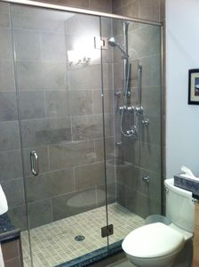 Vertical Spa Shower with 6 nozzles, Italian Contempo Tile and Granite seat.