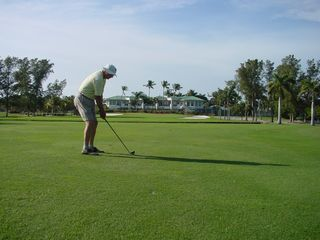 Vacation Homes in Marco Island house photo - Added my Dad playing golf on Marco, just because I like the picture!!