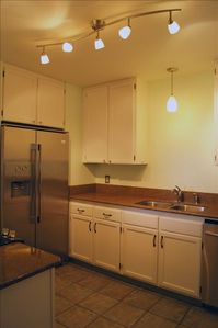 Kitchen. Stainless steel appliances (including Dishwasher, Fridge, and Stove.