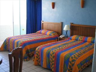 Cancun condo photo - Your Queen bed & double bed in your penthouse studio. Enjoy the views!