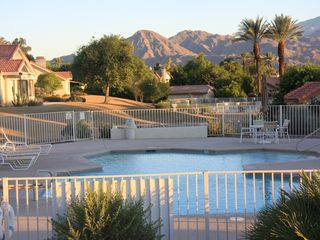 1 of 15 community pools and spas - Palm Desert condo vacation rental photo