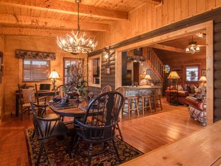 Pigeon Forge cabin photo - large diningroom with computer desk with WIFI adjacent to breakfast bar/kitchen