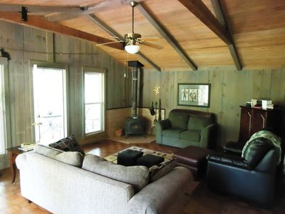 Logan Martin Lake cottage rental - step inside the living room with plenty of seating for gathering and visiting