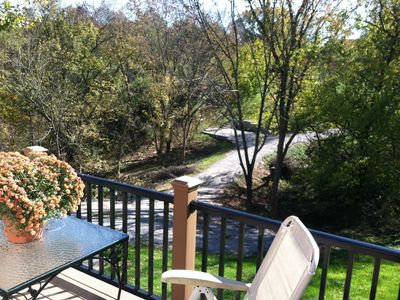 Hebron chateau / country house rental - Front deck view overlooks entry and more forest.