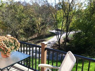 Front deck view overlooks entry and more forest.