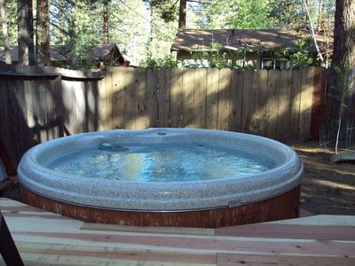New outside hot tub and spacious deck, patio furniture, fenced level yard.