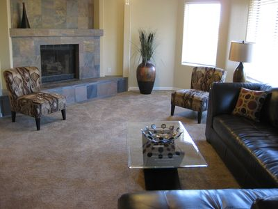 Living Room w/ Beautiful Slate Fireplace and relaxing Leather Sectional