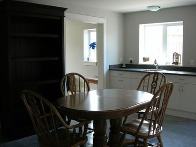 Another kitchen view, showing the dining area
