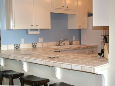 FULLY EQUIPPED KITCHEN WITH ALL NEW DISHES, GLASSWARE, COOKING UTENSILS, ETC.