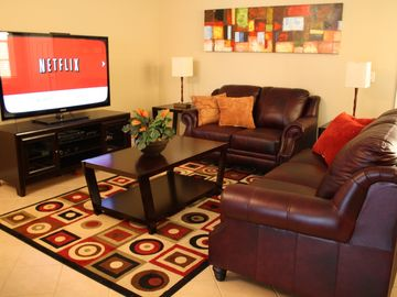 Oakwater townhome rental - 59 inch HDTV. 100% genuine leather couch and love seat. NetFlix, Wii