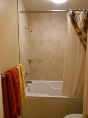 Moab townhome photo - Master bathroom with jacuzzi tub and shower with tile surround.