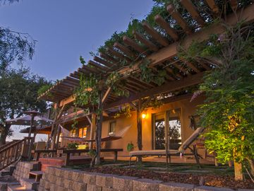 Carmel Valley chateau / country house rental - Full back patio has romantic qualities including a hot tub