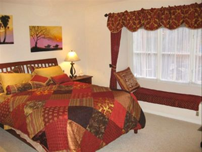 Master bedroom with Posturpedic mattress, views of garden and HDTV