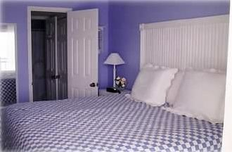 Master suite king size bed different bedding from other photo same room