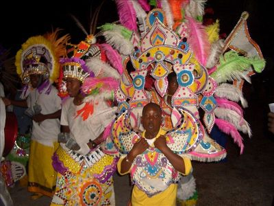 Colorful Junkanoo costume show with Bahamian dancing and music.