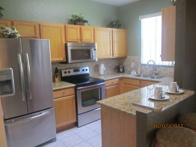 Fully equipped beautiful kitchen with granite counters and stainless appliances