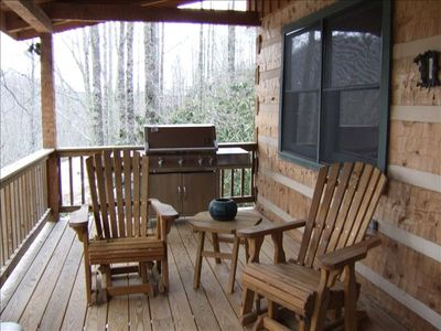 Back porch with gliders, picnic table and gas grill - great for entertaining!