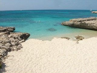 Enjoy a nice private cove nearby for sand, sun, swimming and snorkeling