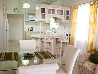 Atlantic Shores apartment photo - The elegantly styled dining area.
