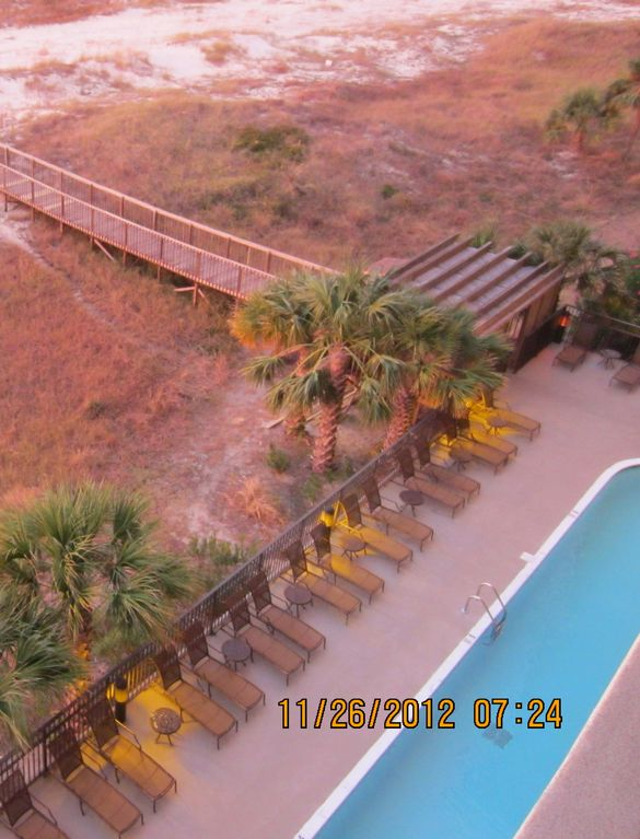 View of pool from balcony (pool is larger than shown in photo