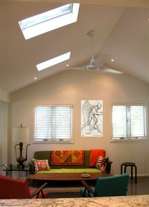 Living Room w/Vaulted Ceiling & Mid-Century Modern Furnishings