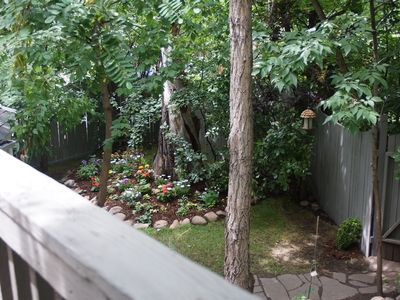 view from deck of gardens and north facing shady yard fenced in for privacy