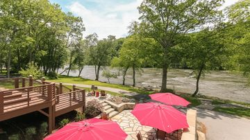 Asheville house rental - Patio seating and a fire pit off the lower level with more river views