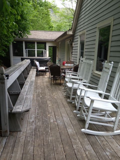 Deck along back of house is private with a wooded rock view.