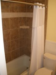 St. Simons Island condo photo - Tiled showers have curved rods to give them that roomy feel.