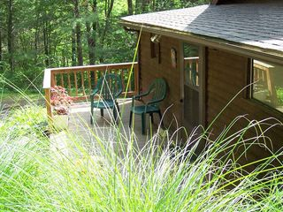 Elkton cabin photo - Front deck with BBQ grill. Relax in a private park-like wooded nature setting.