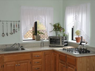 Kitchen has plenty of counter space, convection toaster oven, microwave, etc.