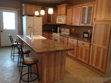 Keosauqua lodge rental - Kitchen & Island with door to the deck and patio.