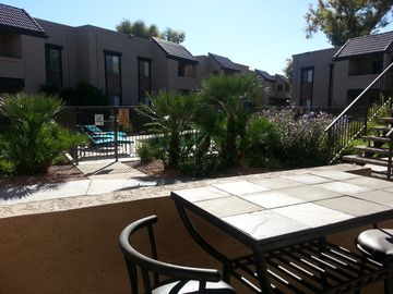 Downtown Scottsdale condo rental - View of the grounds and pool from your patio bistro table ~